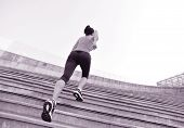 Runner athlete running on escalator stairs. woman fitness jogging workout wellness concept.