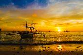 sail boat at sunset sea, boracay island, philippines