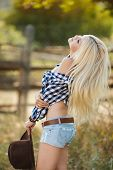 foto of cowboys  - Young woman portrait of a cowboy in the open air - JPG