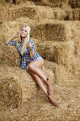 foto of shepherdess  - Sexy fashion woman in cow girl country style on hay stack - JPG