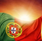 Portuguese flag in front of bright sky