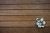 stainless flower on the teak wood board
