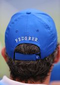 Tennis fan wears  Roger Federer hat during US Open 2014 semifinal match