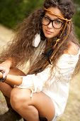 Beautiful hippie girl with black glasses