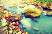 Mountain river with stones. Clear transparent fresh water