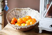image of satsuma  - Citrus  Handmade ceramic bowl filled with oranges - JPG