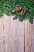Fir branches with cones on wooden boards