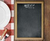 Menu chalkboard top view on table with dish, knife and fork