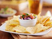 mexican pico de gallo with tortilla chips and beer