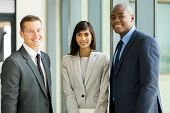 group of multicultural businesspeople standing in modern office