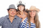 Happy family in hats. On cap emblem of Russia