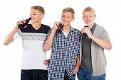 Young guys drink beverages from bottles