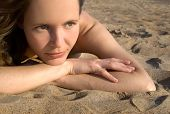 Girl laying on a beach-3