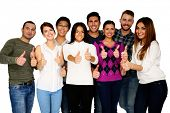 Cheerful group of people with thumbs up - isolated over white