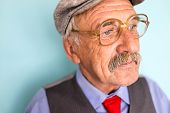 Portrait of aged man with mustache and glasses