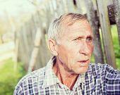 Natural senior man talking