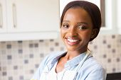 close up portrait of young african female housekeeper