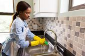 beautiful african american woman doing house chores