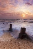 Sunset And Sea Defences