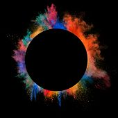 Freeze motion of colored dust explosion in circle shape, isolated on black background