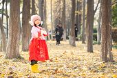 little girl enjoy new year  costume and happily play in forest