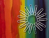 Paperclips on rainbow canvas