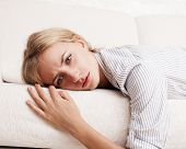 stock photo of grief  - Sad young woman at home - JPG