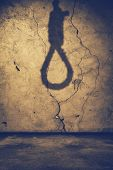 stock photo of hangman  - old interior with shadow of noose - JPG
