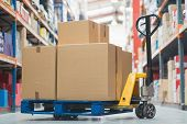 picture of trolley  - Cardboard boxes on trolley in warehouse - JPG