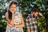 image of argument  - Young couple after an argument on a summers day - JPG