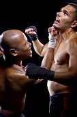 image of sparring  - sparring mma fighters or boxers punching each other - JPG
