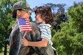 picture of happy day  - Soldier reunited with her son on a sunny day - JPG