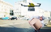 foto of drone  - delivery man and modern drone - JPG