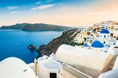 stock photo of greek-architecture  - Beautiful view of Oia town at sunset - JPG