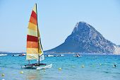 pic of sails  - Scenic Italy Sardinia beach resort landscape with sail boat and mountains - JPG
