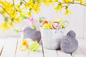 picture of bird egg  - Colorful easter eggs and stone birds on white wooden background - JPG