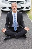 picture of down jacket  - Businessman meditating after his car broken down on the road - JPG