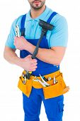 image of plunger  - Plumber with plunger and tool belt on white background - JPG