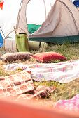 stock photo of bohemian  - Bohemian style campsite at festival on a sunny day - JPG
