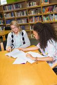 picture of tutor  - Student getting help from tutor in library at the university - JPG