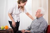 stock photo of geriatric  - Image of young nurse caring about elder man - JPG