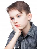 stock photo of upset  - Portrait of upset kid holding his head on white background - JPG