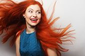pic of flowing hair  - Beautiful young happy woman with long flowing red hair - JPG