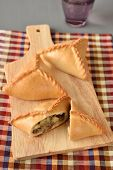 stock photo of tatar  - Three echpochmaks the traditional Tatar pastry with meat and potato - JPG