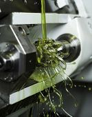 stock photo of lube  - Close up of Green Floating Fluid in a machine - JPG