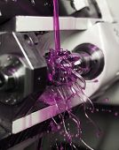 foto of lube  - Close up of Pink Floating Fluid in a machine - JPG