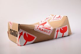 picture of fragile  - brown box with fragile sticker damaged - JPG