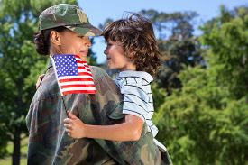 image of veterans  - Soldier reunited with her son on a sunny day - JPG
