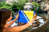 picture of cave woman  - Woman with Bosnian flag in Blagaj village - JPG
