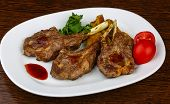 picture of lamb chops  - Grilled lamb chops with sauce and coriander leaves - JPG